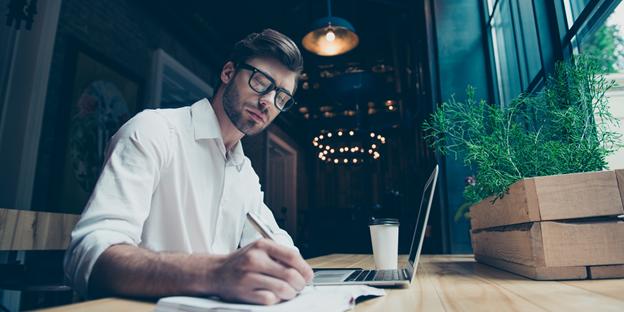 A man writing a business plan.